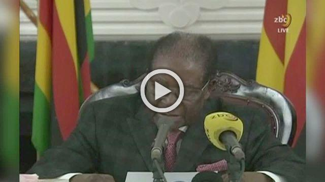 Mugabe defies demands to quit, defying party and protesters