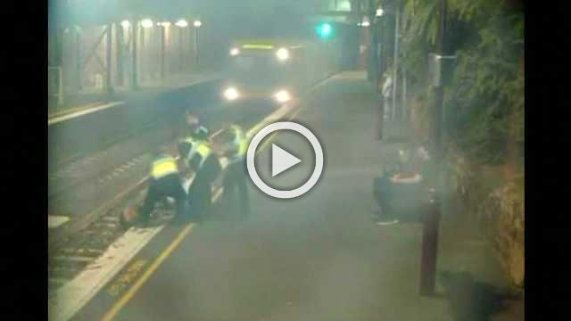 Woman trapped on train track saved by police in Australia