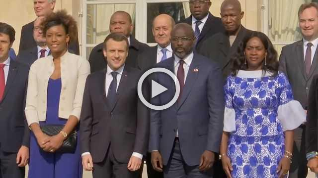Soccer stars and Liberia's new president arrive at Elysee Palace