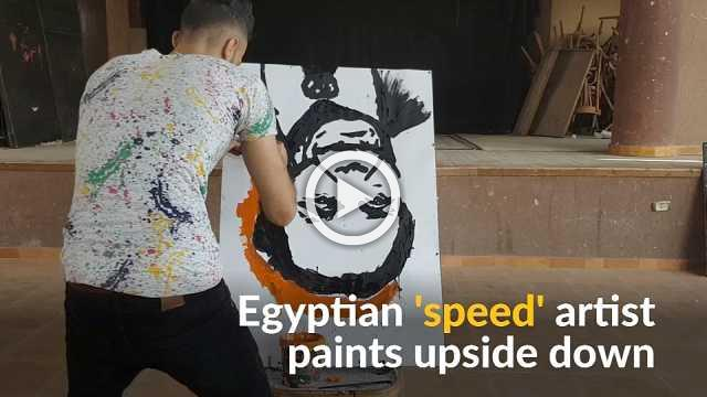 Egyptian speed painter amazes audiences with upside down portraits