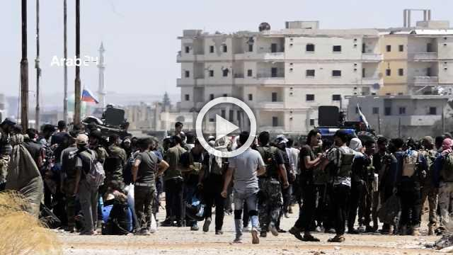 Rebel fighters and their families start leaving Deraa in Syria