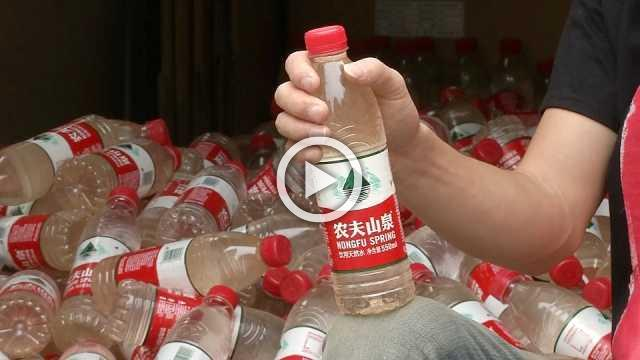 Chinese artist raises water pollution awareness, one bottle at a time
