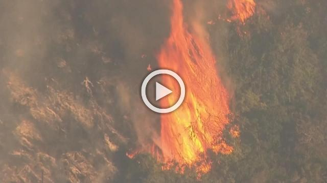 One dead, two hurt battling U.S. wildfires