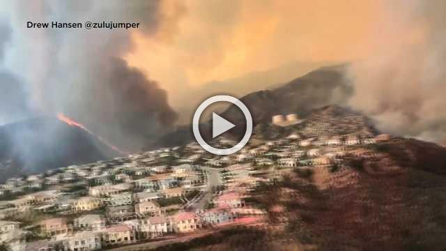 Wilfire menaces thousands in California city