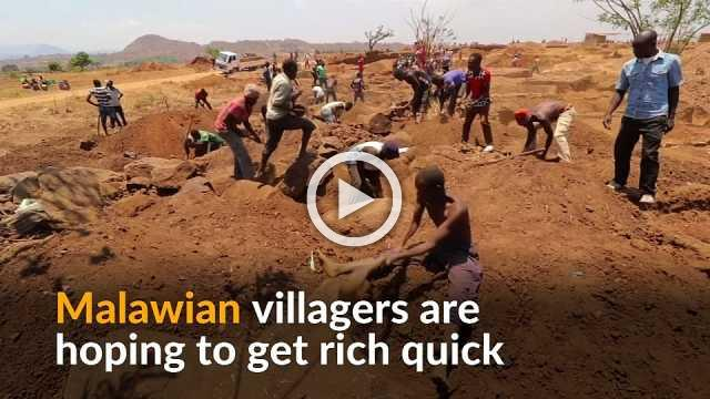Malawian villagers sift through soil in search for gold