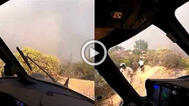 Video shows dramatic rescue in Malibu's Woolsey fire