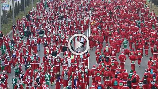 Thousands dressed as Santa Claus race through Madrid for charity