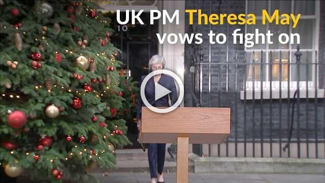 UK PM May remains defiant in face of confidence vote