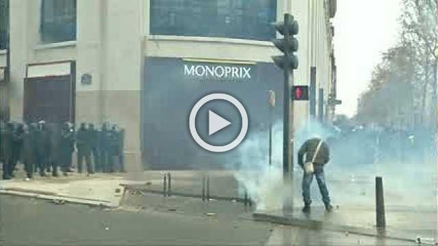 Police use teargas on 'yellow vest' protesters on Champs Elysees