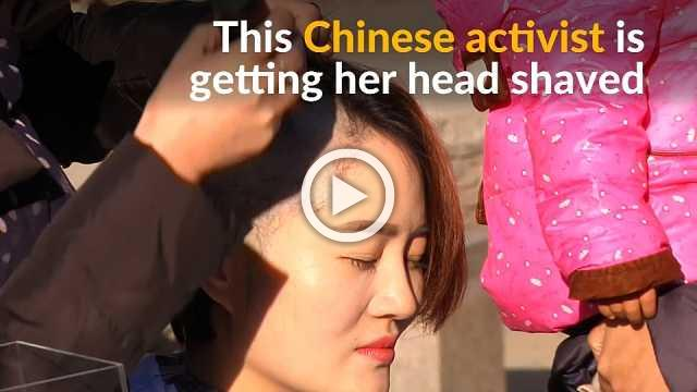 Chinese activists shave heads to protest 'persecution' of husbands