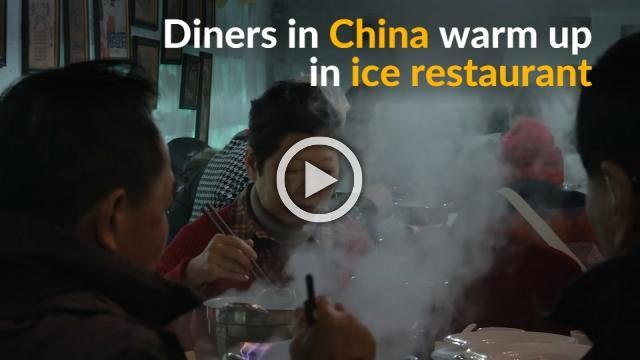 Diners warm up with hot pot during Chinese ice festival