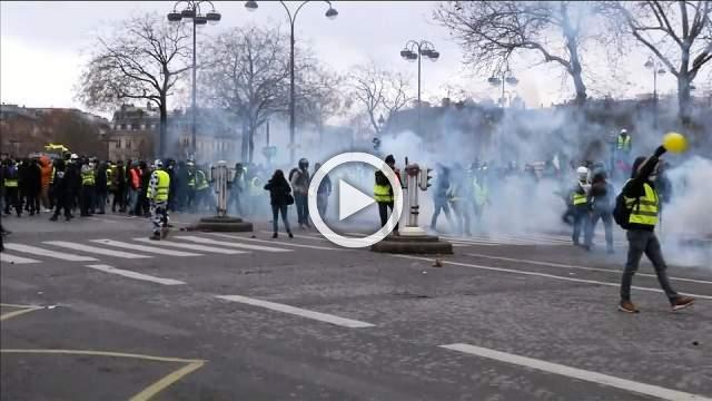 "Teargas fired as ""yellow vest"" protesters clash with police"