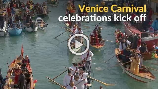Venetians show off their masks and costumes on Carnival gondolas