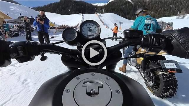 Harley-Davidsons race, slide and crash on snowy slope