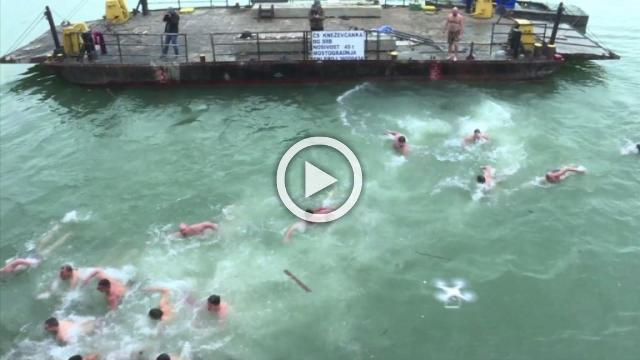 'Serbian Knights' plunge into icy river for Epiphany swim