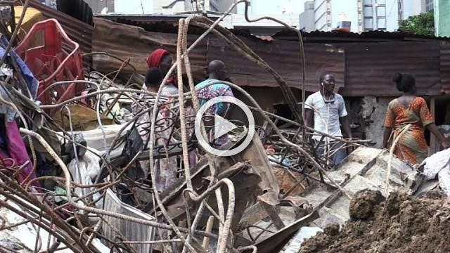 Lagos residents gather at deadly building collapse site