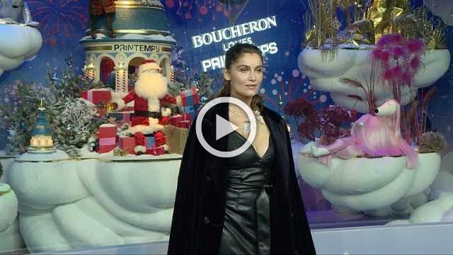 Laetitia Casta, ambassador for Boucheron, unveils Le Printemps' Christmas shop windows in Paris, next to its President Paolo de Cesare.