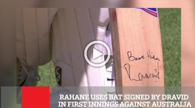 India batsman Ajinkya Rahane played with a bat signed by former India captain Rahul Dravid in the first innings in the first Test against Australia in Adelaide on Thursday.
