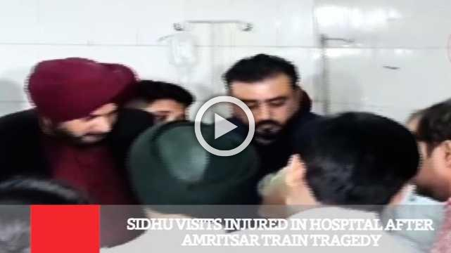 Sidhu Visits Injured In Hospital After Amritsar Train Tragedyc