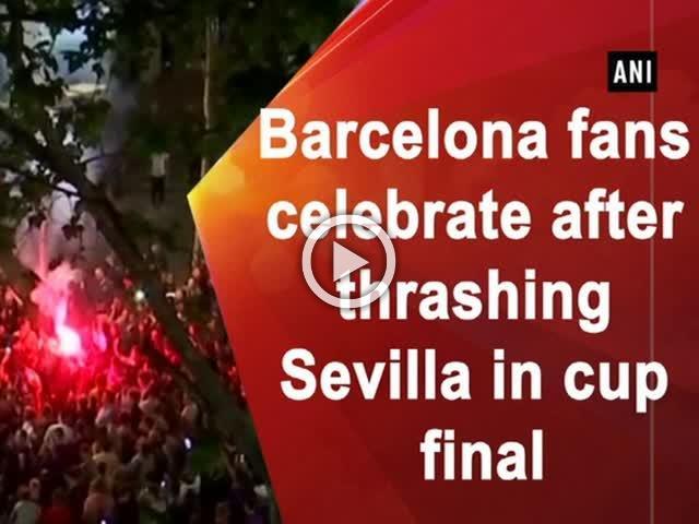 Barcelona fans celebrate after thrashing Sevilla in cup final