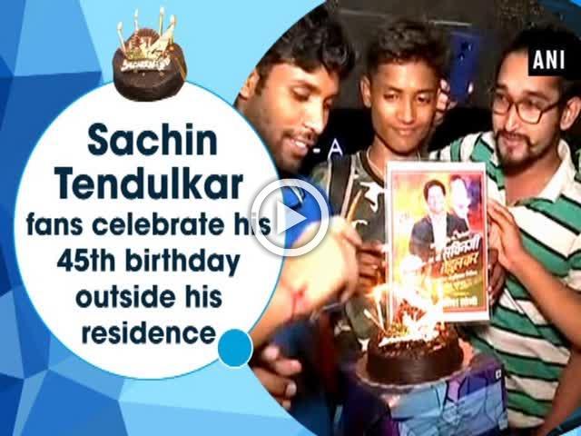 Sachin Tendulkar fans celebrate his 45th birthday outside his residence