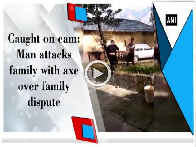 Caught on cam: Man attacks family with axe over family dispute