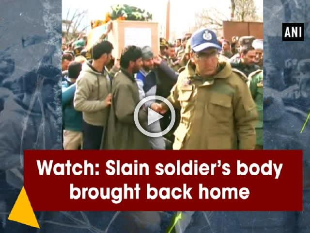 Watch: Slain soldier's body brought back home