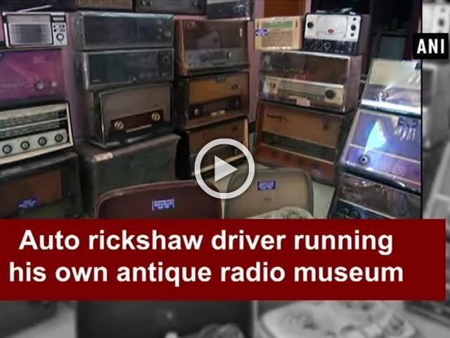 Auto rickshaw driver running his own antique radio museum
