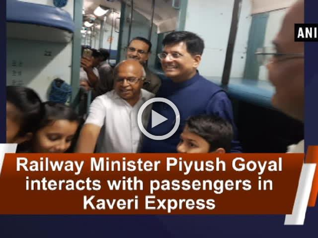 Railway Minister Piyush Goyal interacts with passengers in Kaveri Express