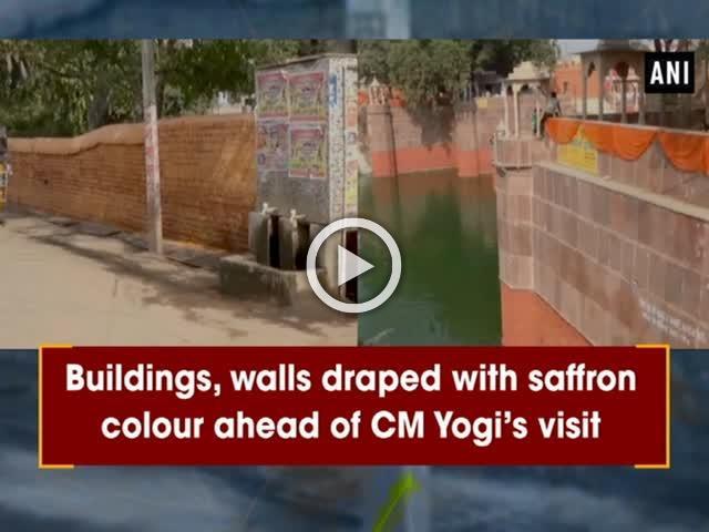 Buildings, walls draped with saffron colour ahead of CM Yogi's visit