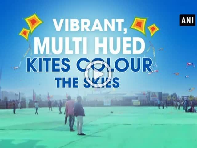 Vibrant, multi hued kites colour the skies
