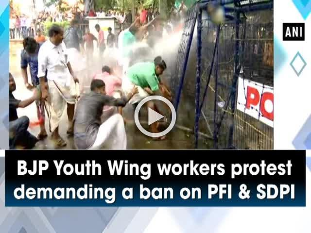 BJP Youth Wing workers protest demanding a ban on PFI and SDPI