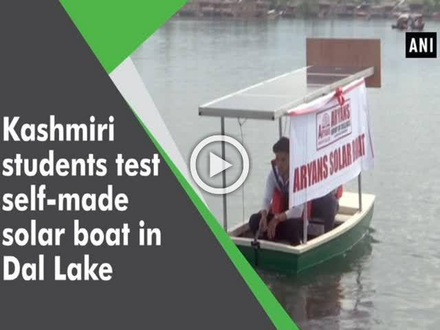 Kashmiri students test self-made solar boat in Dal Lake
