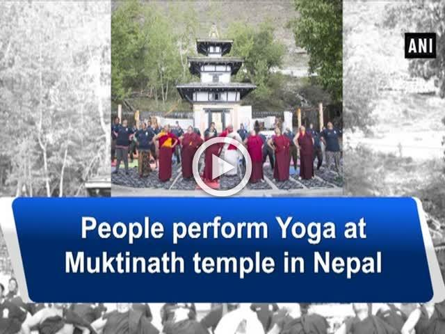 People perform Yoga at Muktinath temple in Nepal