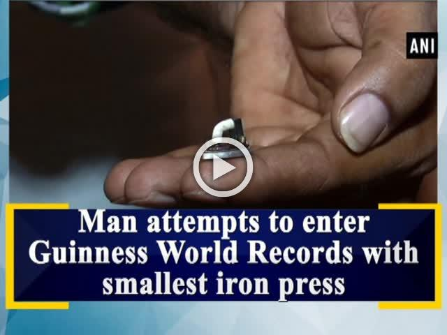 Man attempts to enter Guinness World Records with smallest iron press
