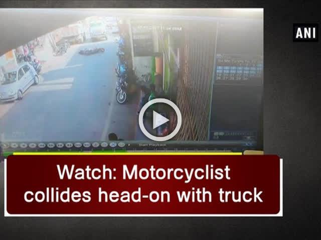 Watch: Motorcyclist collides head-on with truck