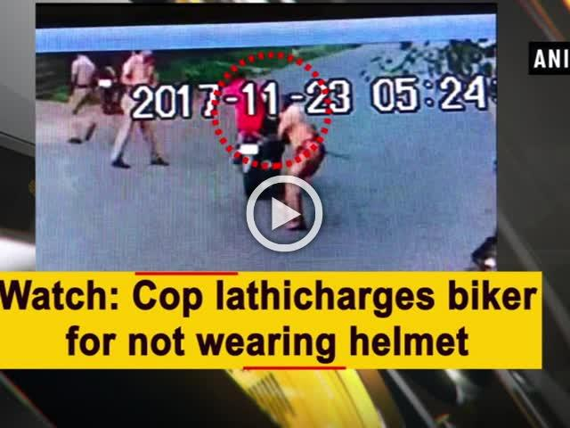 Watch: Cop lathicharges biker for not wearing helmet