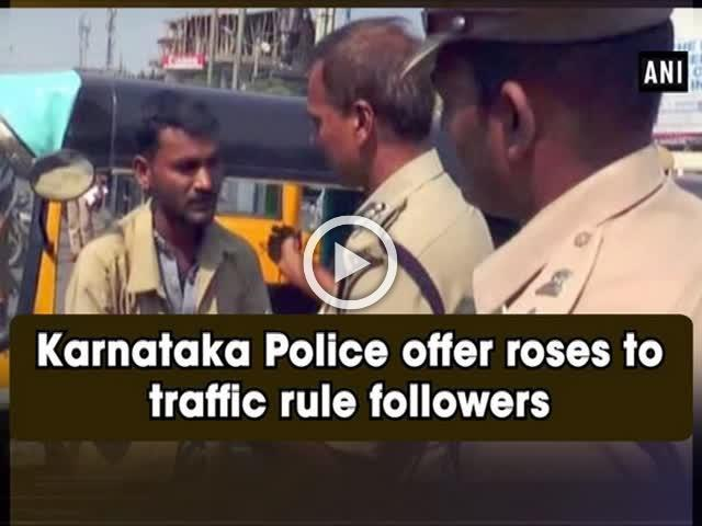 Karnataka Police offer roses to traffic rule followers