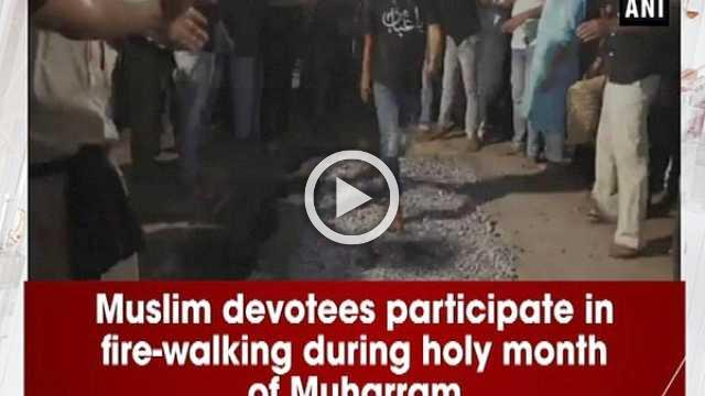 Muslim devotees participate in fire-walking during holy month of Muharram