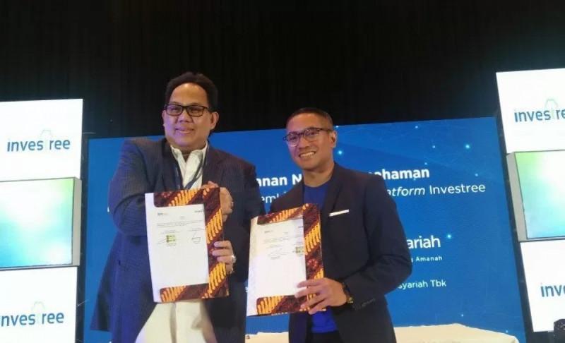 Direktur Bisnis Ritel BRI Syariah Fidri Arnaldy bersama CEO Investree Adrian Gunadi Konferensi Investree 2019 di Thamrin Nine Ballroom, Jakarta, Kamis (12/12/19).(Foto: Dewa Wiguna)