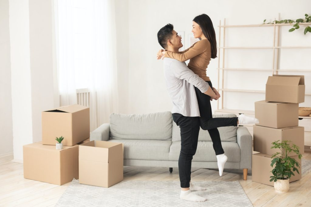 Asian man lifting his beautiful wife up
