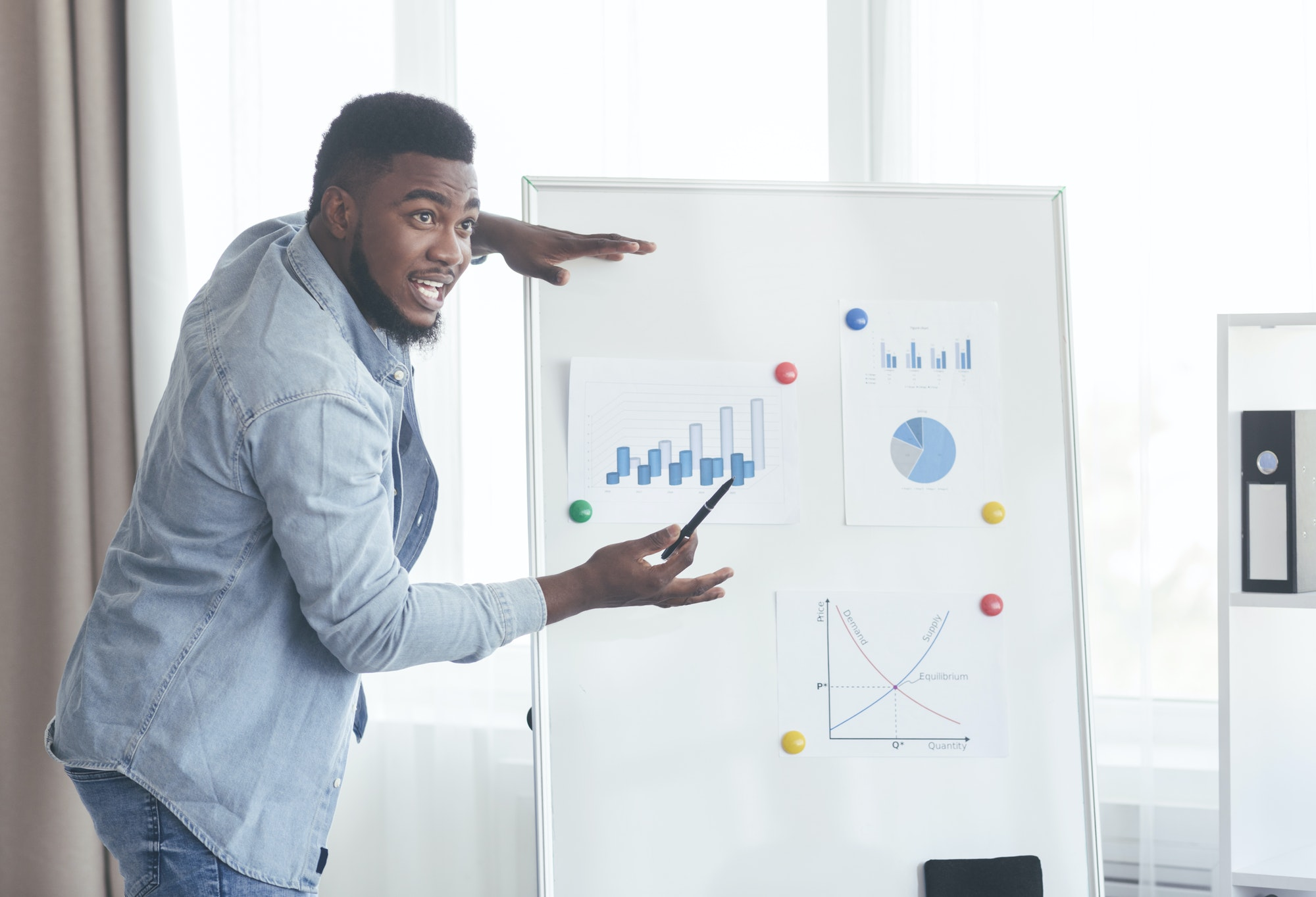Confident top manager presenting company development plan to colleagues