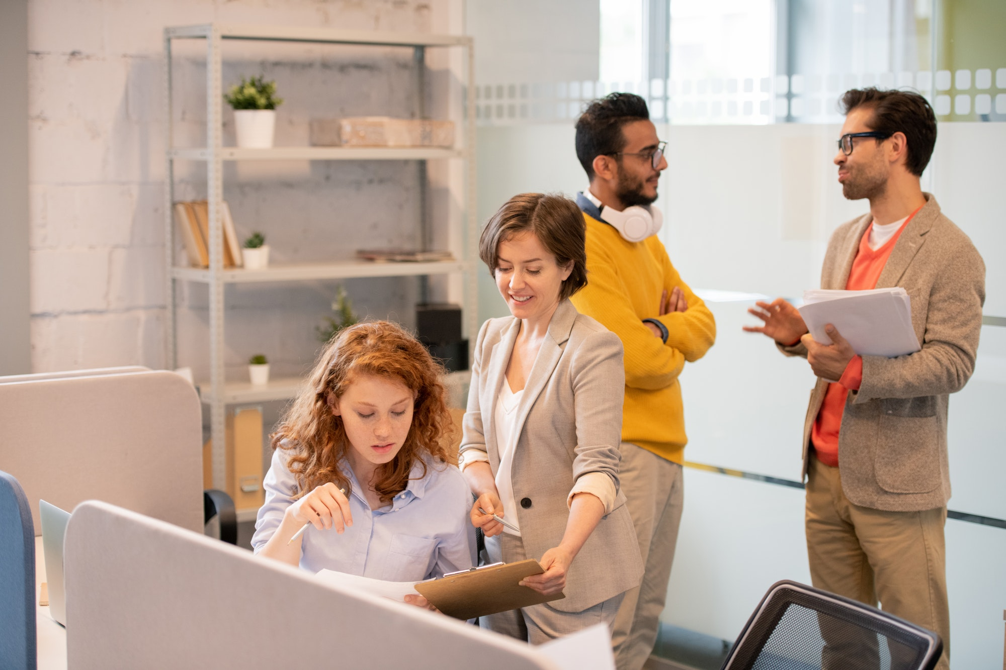 Creative employees working with data in office