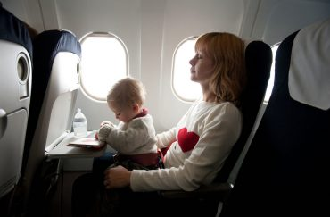 Mother and baby in the plane