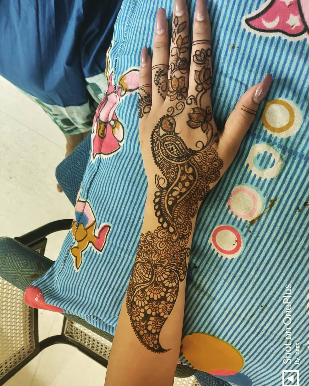 Peacock Back Hand Mehndi design