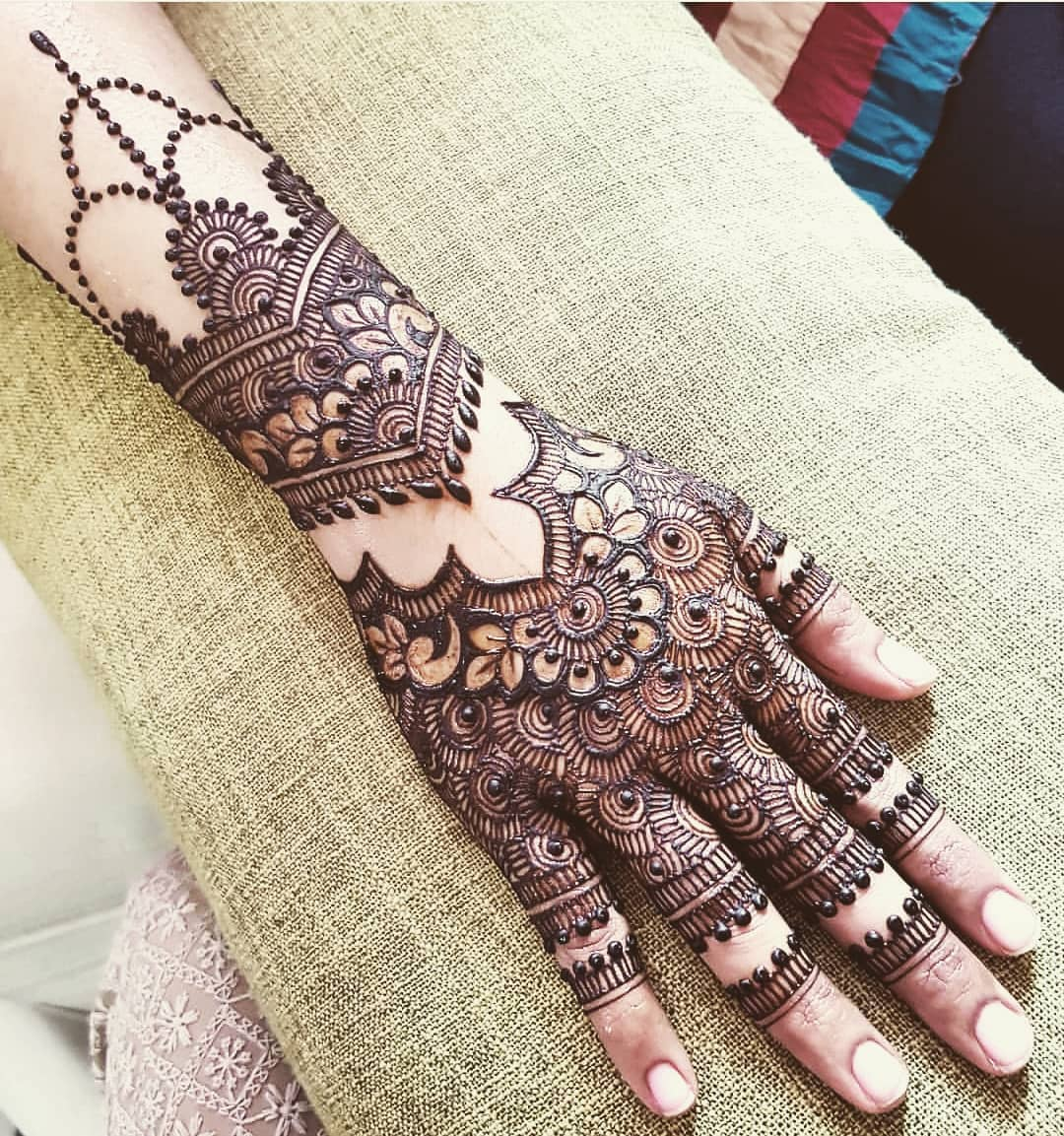 back hand mehandi designs latest