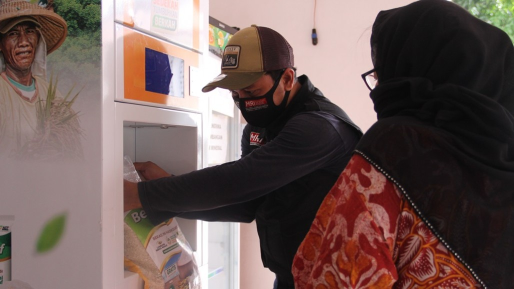 ACT's Automated Rice Dispenser First Launched at Said Naum Mosque' photo