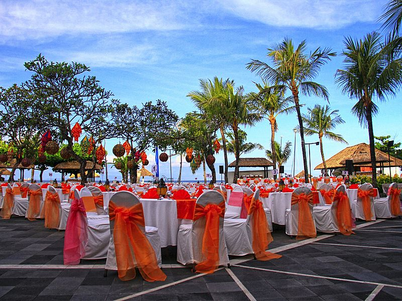 Grand outdoor event venue with many chairs and tables at Grand Mirage Resort and Thalasso Bali (Ballroom/ Chapel Wedding/ Beach Wedding/Rama Stage)
