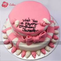 This pretty pink colored fondant double-decker cake for birthdays of pretty girls. The cake is decorated by covering it with some form of icing and then using decorative bows, ribbons and many flowers fondant. Write your birthday wishes on the top of the cake. FREE HOME DELIVERY.   All cakes are baked with hygiene and quality in the top of our priority at our own state-of-the-art baking facility and quality checked twice by our expert QC team before delivery. You can send cakes or gifts to your loved ones in Nepal or shop online for yourself in Nepal with UG Bazaar, a pioneer in online shopping in Nepal.