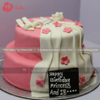 This double deck rolled in pink and white fondant is a dream cake for every princess. If you are going to surprise your loved ones, this delicious cake with a beautiful gown cake will be the best surprise for her. If you would like to change the design in your own way, please provide your information and we will bake according to you. The cake can be delivered online, which is the best online cake delivery service in Kathmandu.   All cakes are baked with hygiene and quality in the top of our priority at our own state-of-the-art baking facility and quality checked twice by our expert QC team before delivery. You can send cakes or gifts to your loved ones in Nepal or shop online for yourself in Nepal with UG Bazaar, a pioneer in online shopping in Nepal.